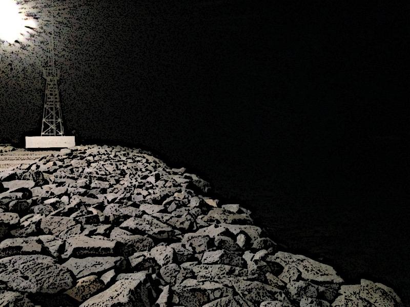 Los Cabos marina breakwater and sea at night