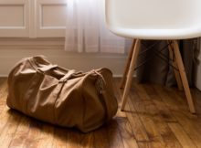 Duffel bag on floor
